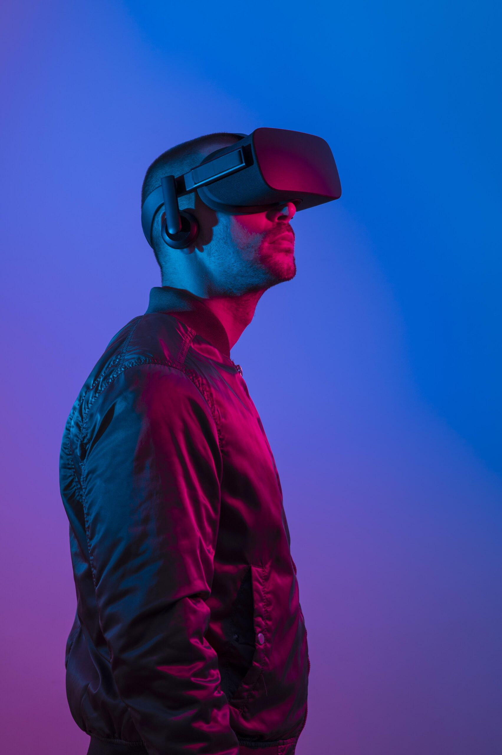 man-wearing-vr-glasses-with-blue-and-purple-light-scaled